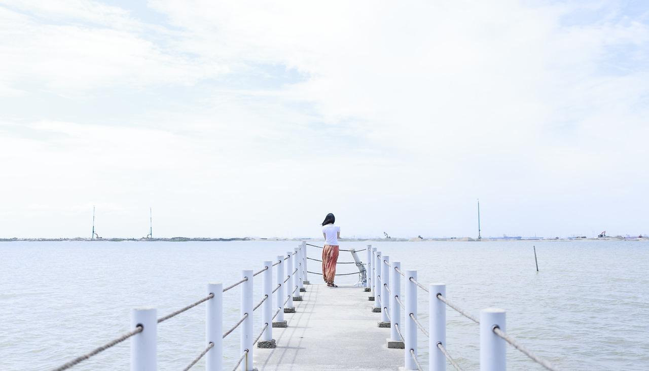 girl pier water