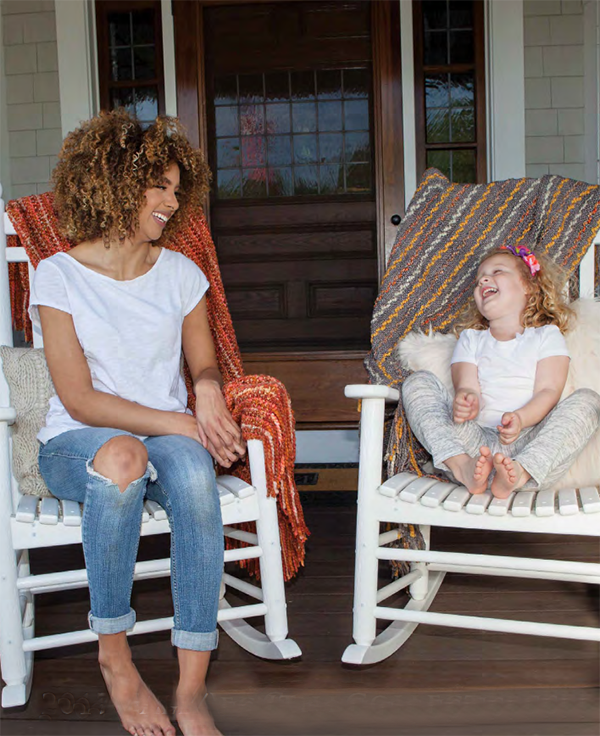 woman and child on porch with woven throw blankets