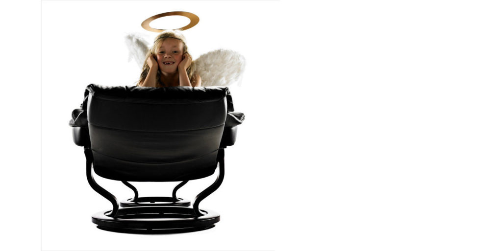 little girl sits in a stressless recliner