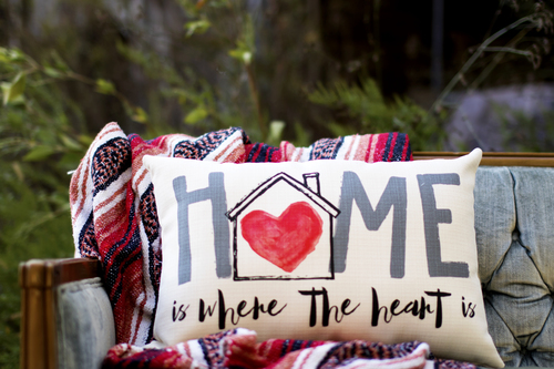 home is where the heart is pillow on sofa