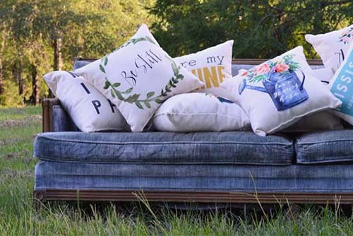 blue couch with little birdie throw pillows