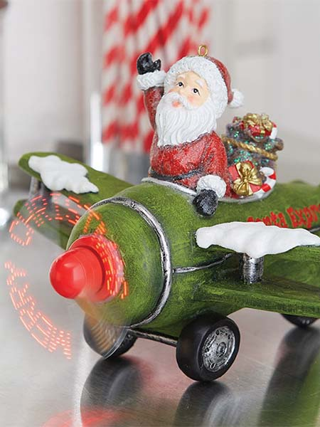 raz imports ANIMATED MUSICAL SANTA IN PLANE
